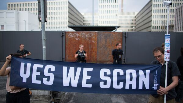 Demonstrators hold a banner during a protest against the supposed surveillance by the US National Security Agency, NSA, and the German intelligence agency, BND, during a rally in front of the construction site of the new headquarters of German intelligence agency in Berlin, Germany - Sputnik International