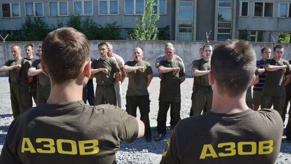 Recruits of the Ukrainian Azov regiment line-up after their final tests at a base in Kiev - Sputnik International