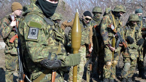 Fighters of Ukrainian volonteer Azov battalion take part in military exercises not far southeastern Ukrainian city of Mariupol, on February 27, 2015 - Sputnik International