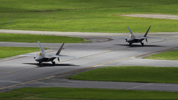 In this Aug. 14, 2012 photo, two U.S. Air Force F-22 Raptor stealth fighters taxi before take-off at Kadena Air Base on the southern island of Okinawa in Japan - Sputnik International