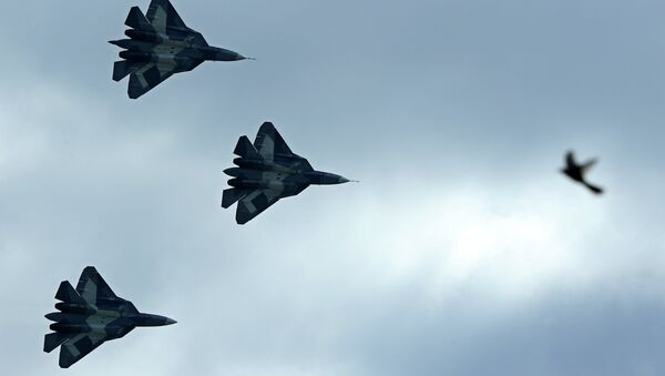 Russia's stealth fighters T-50 perform during the MAKS-2013, the International Aviation and Space Show, in Zhukovsky, outside Moscow, on August 27, 2013 - Sputnik International