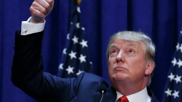US Republican presidential candidate, real estate mogul and TV personality Donald Trump acknowledges supporters while formally announcing his campaign for the 2016 Republican presidential nomination during an event at Trump Tower in New York June 16, 2015 - Sputnik International