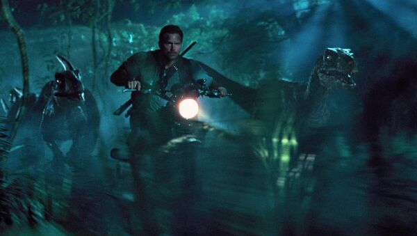 This photo, provided by Universal Pictures, shows Chris Pratt as Owen leading the raptors on a mission in a scene from the film Jurassic World. - Sputnik International