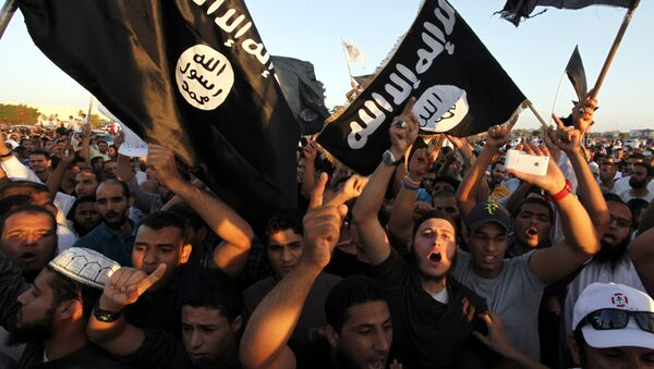 In this Sept. 21, 2012 file photo, Libyan followers of Ansar al-Shariah Brigades and other Islamic militias, hold a demonstration against a film and a cartoon denigrating the Prophet Muhammad in Benghazi, Libya - Sputnik International