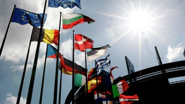 Flags are seen at the European Parliament Wednesday April 16, 2014 in Strasbourg, eastern France. The European general elections in the 27 countries of the E.U will take place from May 22 to 25, 2014 - Sputnik International