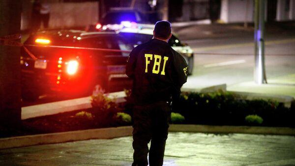 An FBI agent walks across the street from the Emanuel AME Church following a shooting Wednesday, June 17, 2015, in Charleston, S.C. - Sputnik International