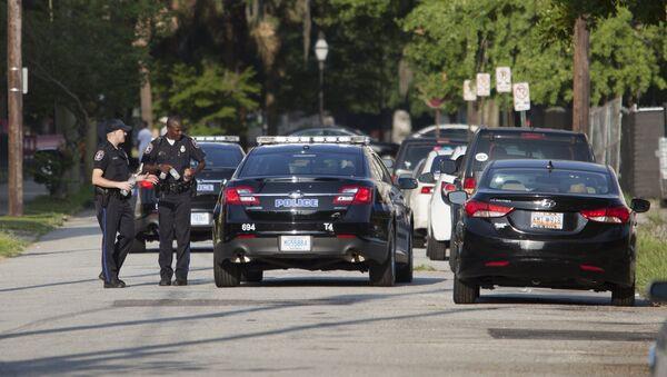 Charleston police man a barricade behind the Emanuel African Methodist Episcopal Church in Charleston, South Carolina, June 18, 2015 - Sputnik International