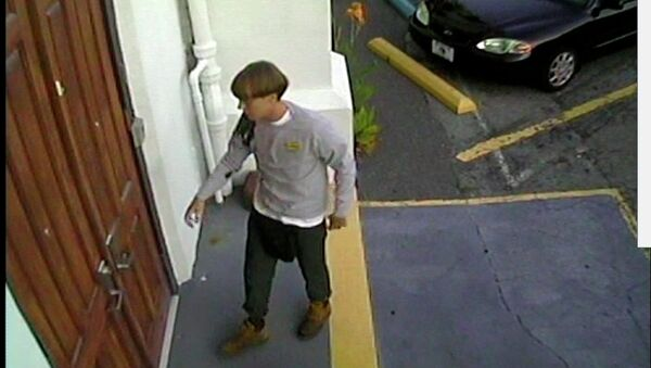 A suspect which police are searching for in connection with the shooting of several people at a church in Charleston, South Carolina is seen in a still image from CCTV footage released by the Charleston Police Department June 18, 2015 - Sputnik International