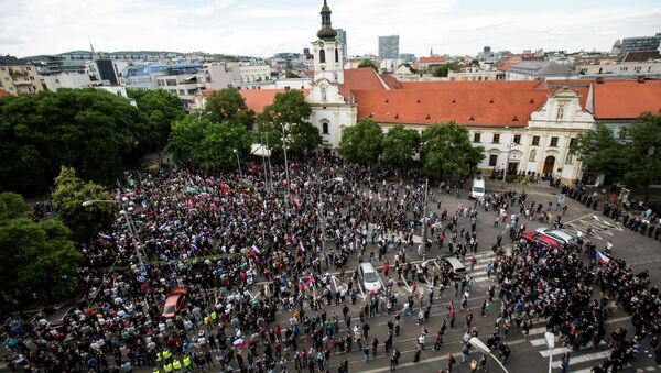 Participants gather during an anti-immigration rally organised by an initiative called Stop Islamisation of Europe and backed by the far-right People's Party-Our Slovakia in Bratislava, Slovakia - Sputnik International