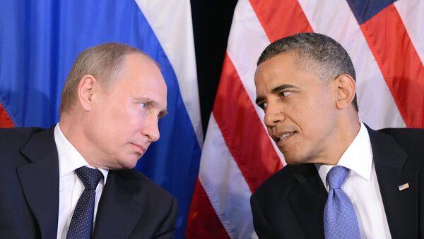 US President Barack Obama (R) listens to Russian President Vladimir Putin - Sputnik International
