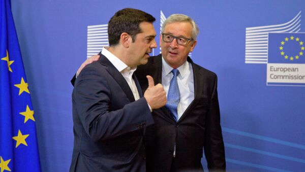 Greek Prime Minister Alexis Tsipras, left, speaks with European Commission President Jean-Claude Juncker as he arrives for a meeting prior to an EU summit at EU headquarters in Brussels - Sputnik International