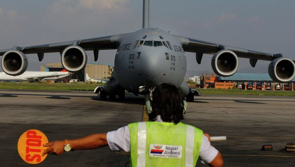 A US Air Force Boeing C-17 Globemaster III lands in Tribhuvan International Airport in Kathmandu, Nepal. - Sputnik International
