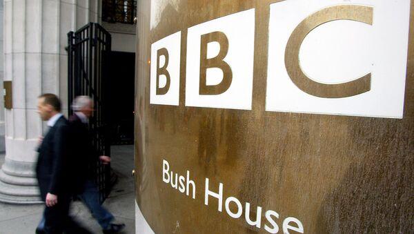Pedestrians walks past the doors of the BBC's Bush House in London. File photo - Sputnik International