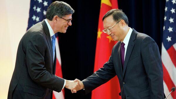 US Treasury Secretary Jack Lew shakes hands with China's State Councilor Yang Jiechi at the 7th US China Strategic and Economic Dialogue in Washington. - Sputnik International