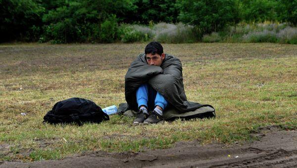 An Afghan refugee rests on the Hungarian Serbian border area near Asotthalom, Hungary. - Sputnik International