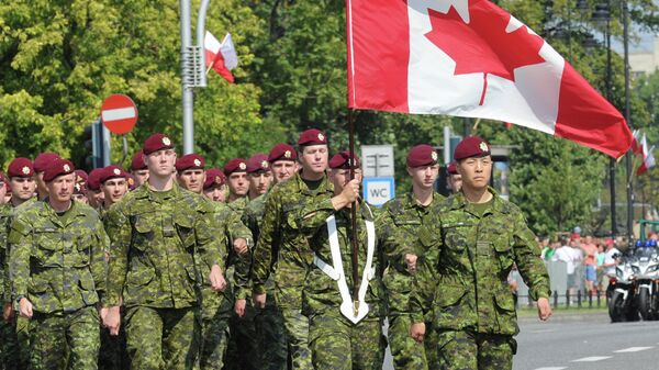 A military unit from Canada marches during a military parade marking Polish Armed Forces Day, in Warsaw, Poland, Friday, Aug. 15, 2014 - Sputnik International