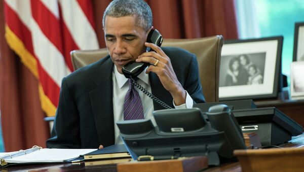 US President Barack Obama speaks on the phone in the Oval Office of the White House - Sputnik International