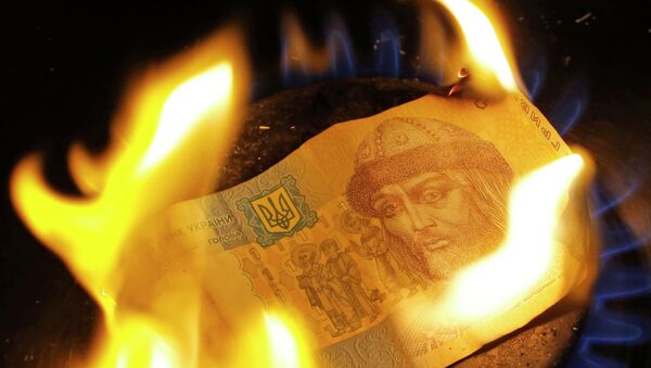 A burning one hryvnia bill - Sputnik International