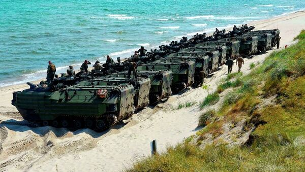 United States Marine Corps amphibious assault vehicles line up to return to their ship following an amphibious assault exercise during Baltic Operations (BALTOPS) 2015. - Sputnik International