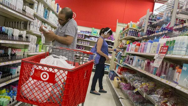 Customers shop in the pharmacy department of a Target store in New York, in this file photo taken June 15, 2015 - Sputnik International