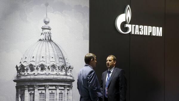 Men speak near the pavilion of Gazprom company at the St. Petersburg International Economic Forum 2015 (SPIEF 2015) in St. Petersburg, Russia, June 18, 2015 - Sputnik International