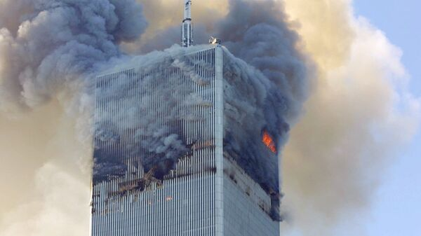 Fire and smoke billows from the north tower of New York's World Trade Center Tuesday Sept. 11, 2001 after terrorists crashed two hijacked airliners into the World Trade Center and brought down the twin 110-story towers. - Sputnik International