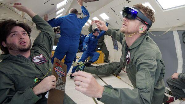 NASA and Microsoft engineers test Project Sidekick on NASA's Weightless Wonder C9 jet. Project Sidekick will use Microsoft HoloLens to provide virtual aid to astronauts working on the International Space Station. - Sputnik International