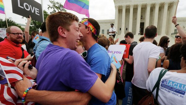 Gay rights supporters celebrate after the U.S. Supreme Court ruled that the U.S. Constitution provides same-sex couples the right to marry, outside the Supreme Court building in Washington, June 26, 2015 - Sputnik International
