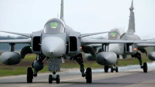 Saab JAS 39 Gripen (Griffin) fighter aircraft taxi out for start during the NATO exercise Loyal Arrow outside Lulea in northern Sweden, on June 10, 2009 - Sputnik International