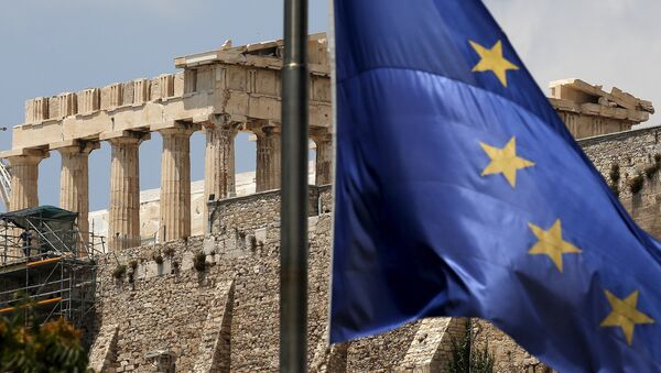 A European Union flag flutters before the temple of Parthenon at the Acropolis hill in Athens, Greece - Sputnik International