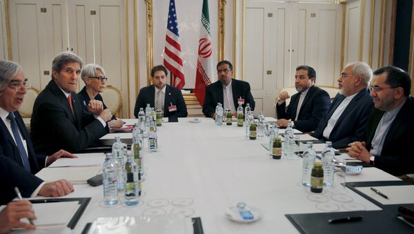 U.S. Secretary of Energy Ernest Moniz, U.S. Secretary of State John Kerry and U.S. Under Secretary for Political Affairs Wendy Sherman (L-3rd L) meet with Iranian Foreign Minister Mohammad Javad Zarif (2nd R) at a hotel in Vienna, Austria - Sputnik International