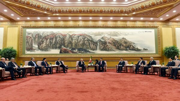 Chinese President Xi Jinping, center right, speaks to Swiss Economy Minister Johann Schneider-Ammann as he meets with delegates attending the signing ceremony for the Articles of Agreement of the Asian Infrastructure Investment Bank (AIIB) at the Great Hall of the People in Beijing - Sputnik International
