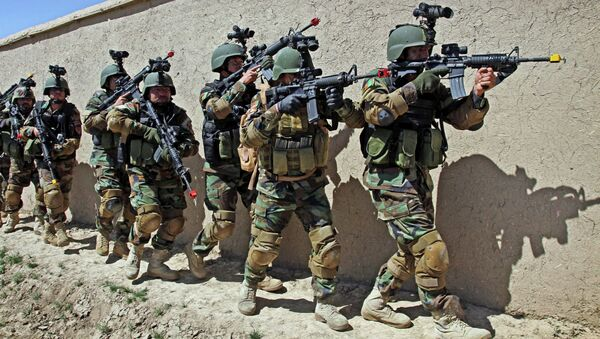 In this Thursday, April 12, 2012 file photo, Afghan special forces demonstrate a raid for rescuing a hostage during a showing at the commando training center in Kabul, Afghanistan. - Sputnik International