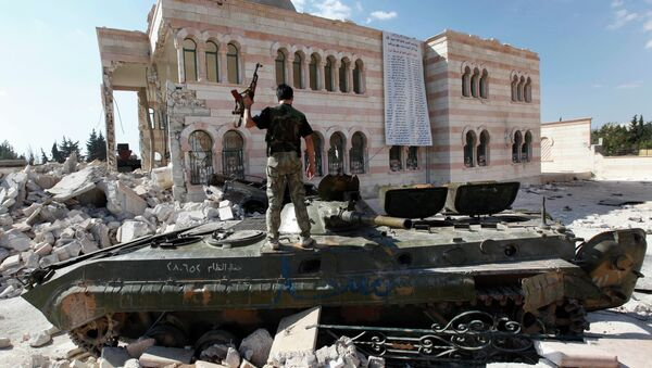 Free Syrian Army soldier stands on a damaged Syrian military tank in front of a damaged mosque, which were destroyed during fighting with government forces, in the Syrian town of Azaz. - Sputnik International