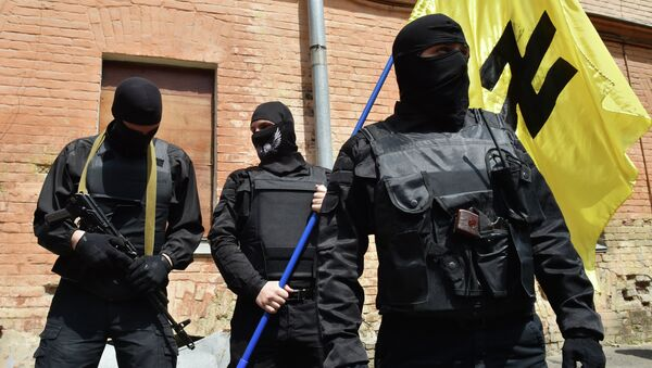 Fighters of Social Nationalist Assembly (SNA), part of the ultra-nationalist Right Sector party, attend a swearing-in ceremony in Kiev prior to leaving on June 3, 2014 - Sputnik International