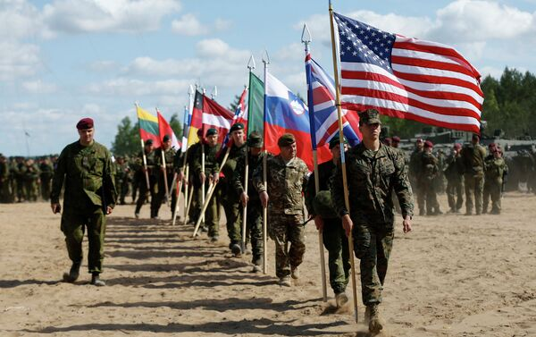 Soldiers from NATO countries attend an opening ceremony of military exercise 'Saber Strike 2015'. - Sputnik International