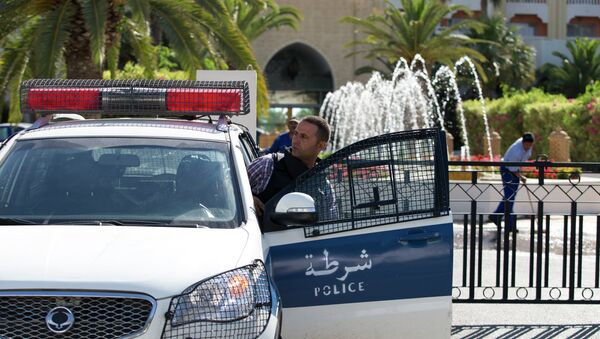 A Tunisian police car patrols in front of the Riu Imperial Marhaba Hotel in Port el Kantaoui, on the outskirts of Sousse south of the capital Tunis, on June 27, 2015 - Sputnik International