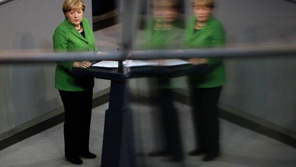 German Chancellor Angela Merkel delivers her speech at the German parliament Bundestag in Berlin. - Sputnik International