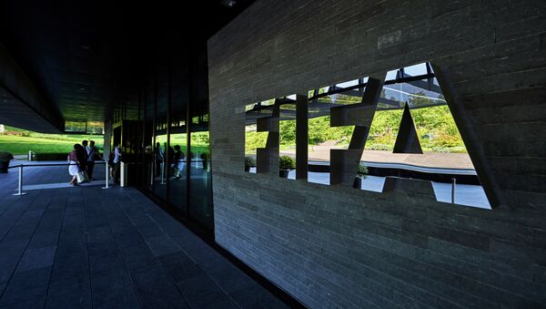 This file photo taken on June 3, 2015 shows FIFA employees entering the FIFA headquarters in Zurich - Sputnik International