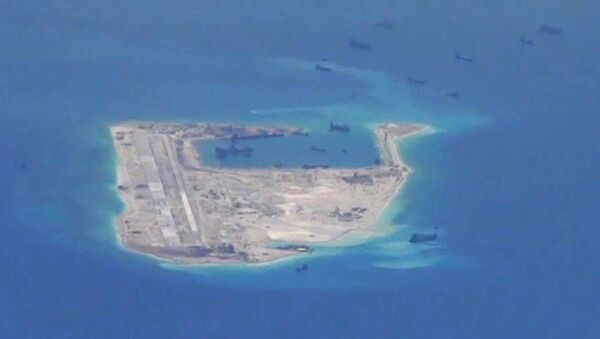 Chinese dredging vessels are purportedly seen in the waters around Fiery Cross Reef. - Sputnik International