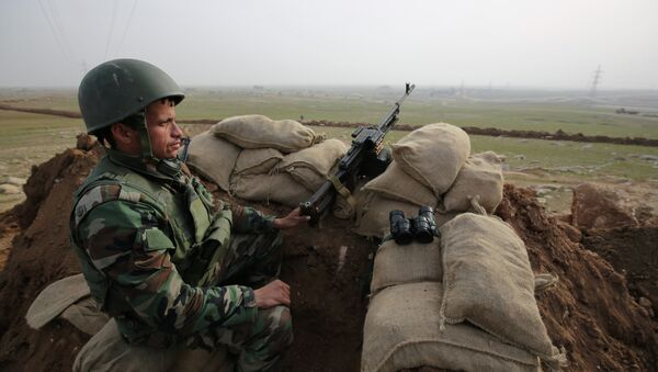 In this Tuesday, Jan. 27, 2015 photo, a Kurdish Peshmerga soldier stands guard, overlooking the road between Mosul and Tal afar at the frontline of Eski Mosul. - Sputnik International