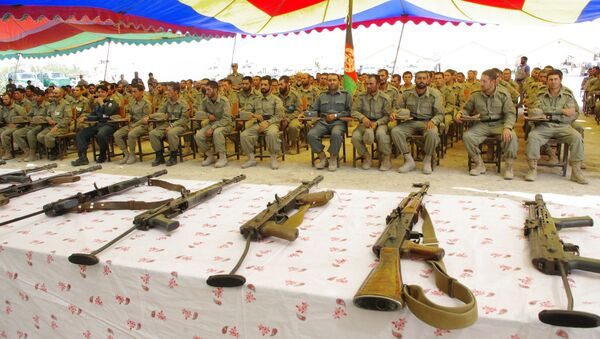 Afghan Local Police (ALP) attend during their graduation ceremony in Laghman province on June 24, 2013. - Sputnik International