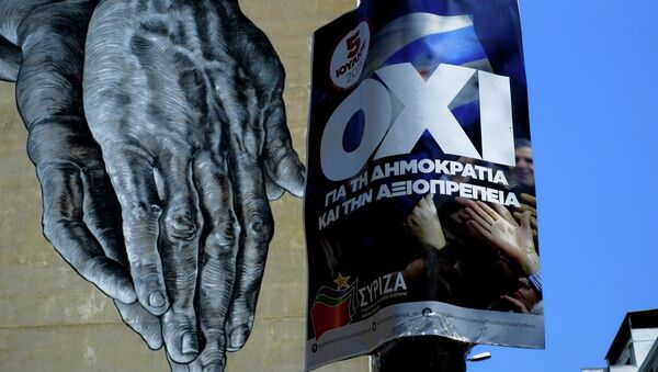 Hands painted on the wall of a building seen behind a poster for a NO vote in the upcoming referendum, in central Athens, Wednesday, July 1, 2015. - Sputnik International