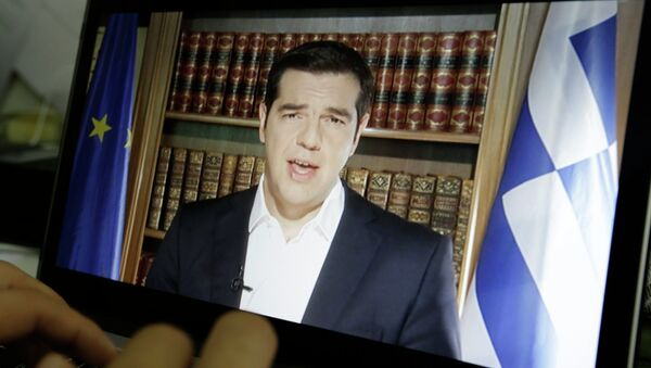An Associated Press TV producer edits the video of Greece's Prime Minister Alexis Tsipras televised address to the nation in Athens, Friday, July 3, 2015 - Sputnik International