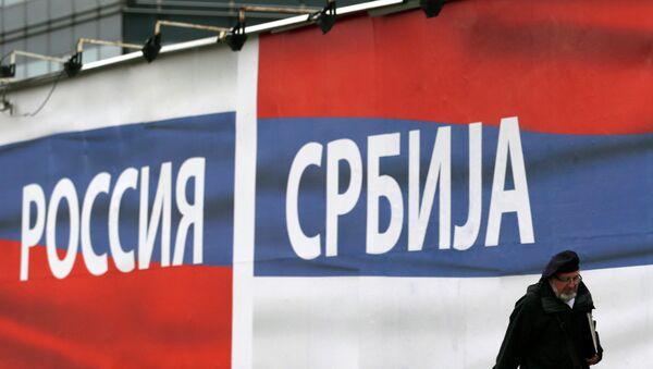 A man walks past by billboards reading Russia, left and Serbia, in Belgrade, Serbia, Friday, Oct. 17, 2014 - Sputnik International