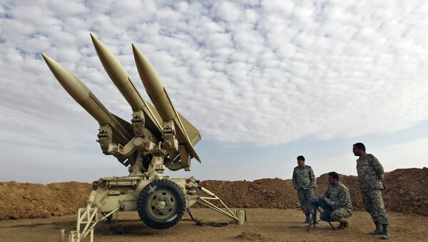 In this Nov. 13, 2012 file photo obtained from the Iranian Mehr News Agency, Iranian army members prepare missiles to be launched, during a maneuver, in an undisclosed location in Iran - Sputnik International
