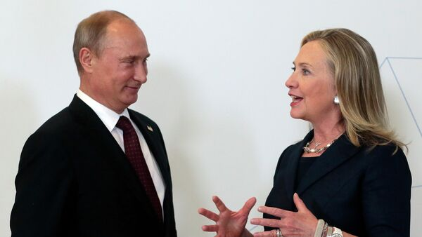 Russian President Vladimir Putin, left, meets U.S. Secretary of State Hillary Rodham Clinton on her arrival at the APEC summit in Vladivostok, Russia, Saturday, Sept. 8, 2012. - Sputnik International