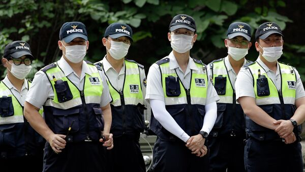 Police officers wearing masks as a precaution against Middle East Respiratory Syndrome (MERS) stand guard during a rally in Seoul, South Korea - Sputnik International