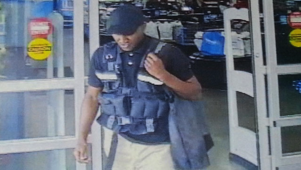 CCTV image of a man who posed as an armored car guard letting him carry $75,000 out from a Walmart - Sputnik International