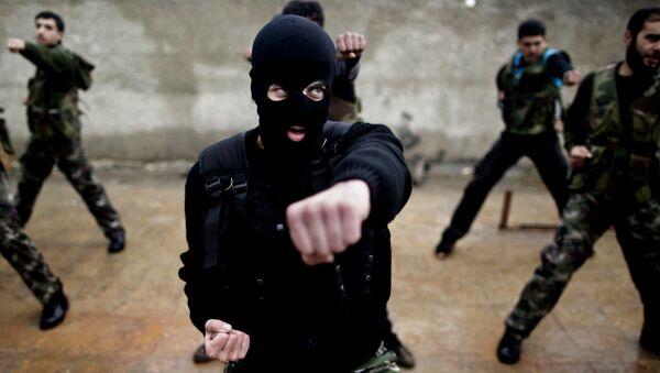 Syrian rebels attend a training session in Maaret Ikhwan, near Idlib, Syria in 2012. - Sputnik International